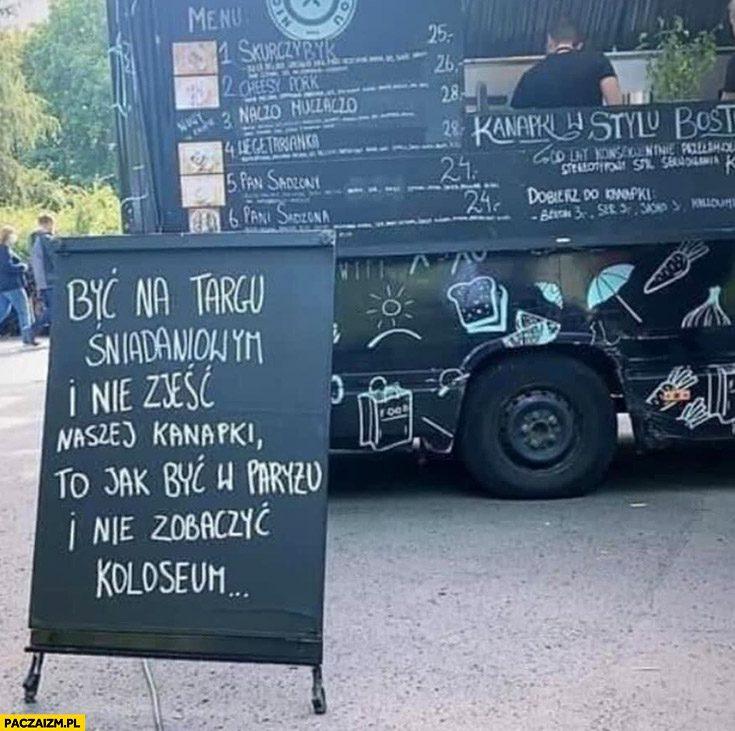 Zdjęcie przedstawiające tablicę natle food trucka.